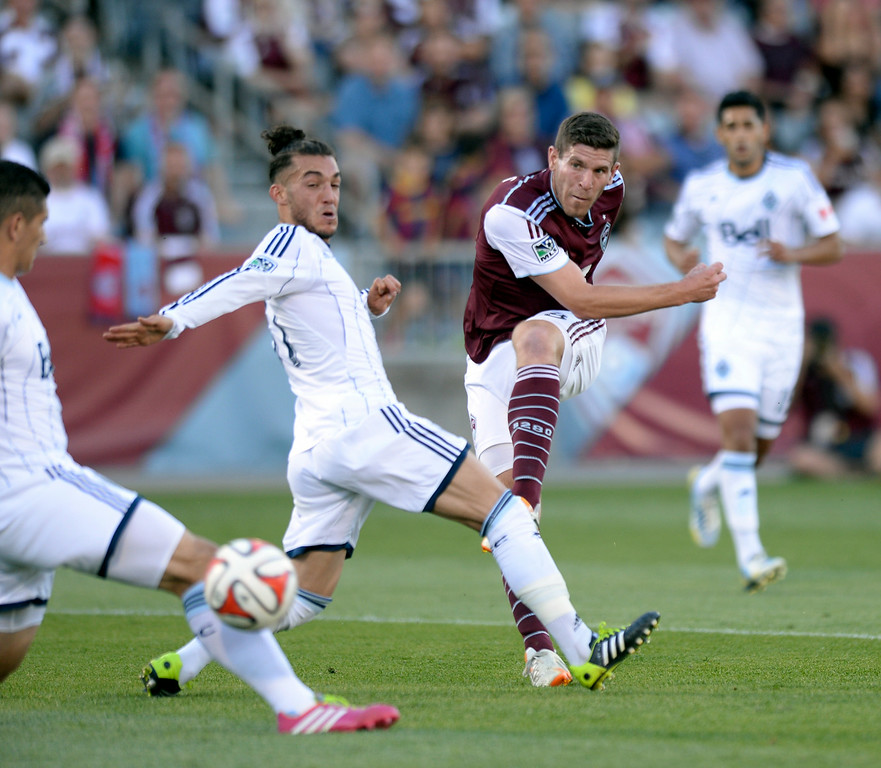 . COMMERCE CITY, CO - JUNE 28: Colorado forward Dillon Powers (8) put a powerful shot into the back of the net for the first Rapids goal in the first half. The Colorado Rapids hosted the Vancouver Whitecaps at Dick\'s Sporting Goods Park Saturday night, June 28, 2014.  Photo by Karl Gehring/The Denver Post