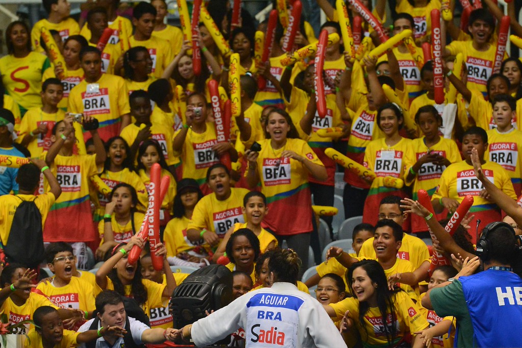. Brazil\'s Mayra Aguiar celebrates with fans after defeating Canada\'s Catherine Roberge for the bronze of the women\'s -78kg category, during the IJF World Judo Championship, in Rio de Janeiro, Brazil, on August 30, 2013.  YASUYOSHI CHIBA/AFP/Getty Images
