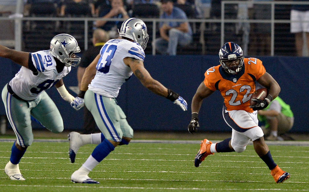 . ARLINGTON, TX - AUGUST 28: Denver Broncos running back C.J. Anderson (22) picks up a big gain as Dallas Cowboys linebacker Keith Smith (43) moves in for he tackle during the second quarter August 28, 2014 at AT&T Stadium. (Photo by John Leyba/The Denver Post)