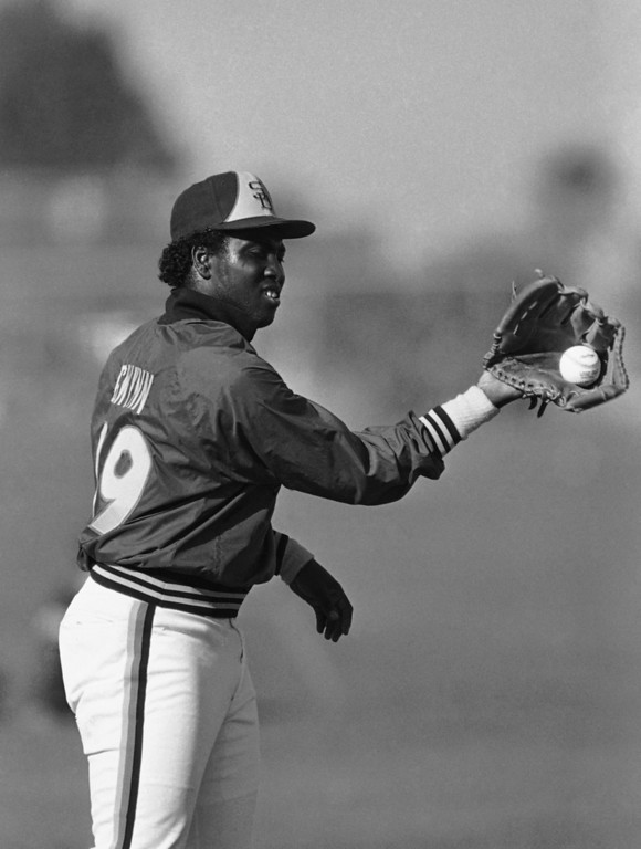 . San Diego Padres\' Tony Gwynn, the National League batting champion in 1984, does a twist to make a back hand catch at the teams\' spring training camp in Yuma, Arizona Tuesday, March 6, 1985. (AP Photo/Lenny Ignelzi)