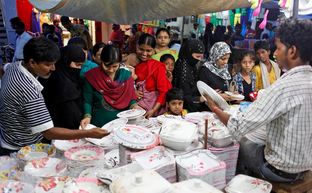 . Indian Muslims shop on the eve of Eid al-Fitr in Allahabad, India,Thursday, Aug.8, 2013. Muslims throughout the world are marking the month of Ramadan, the holiest month in Islamic calendar during which devotees fast from dawn till dusk. (AP Photo/Rajesh Kumar Singh)