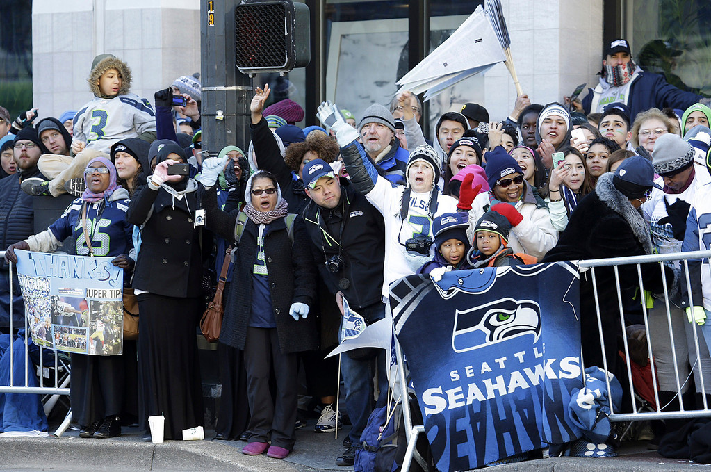 . Seattle Seahawks fans cheer along the route of the Super Bowl champions parade on Wednesday, Feb. 5, 2014, in Seattle. (AP Photo/Ted S. Warren)