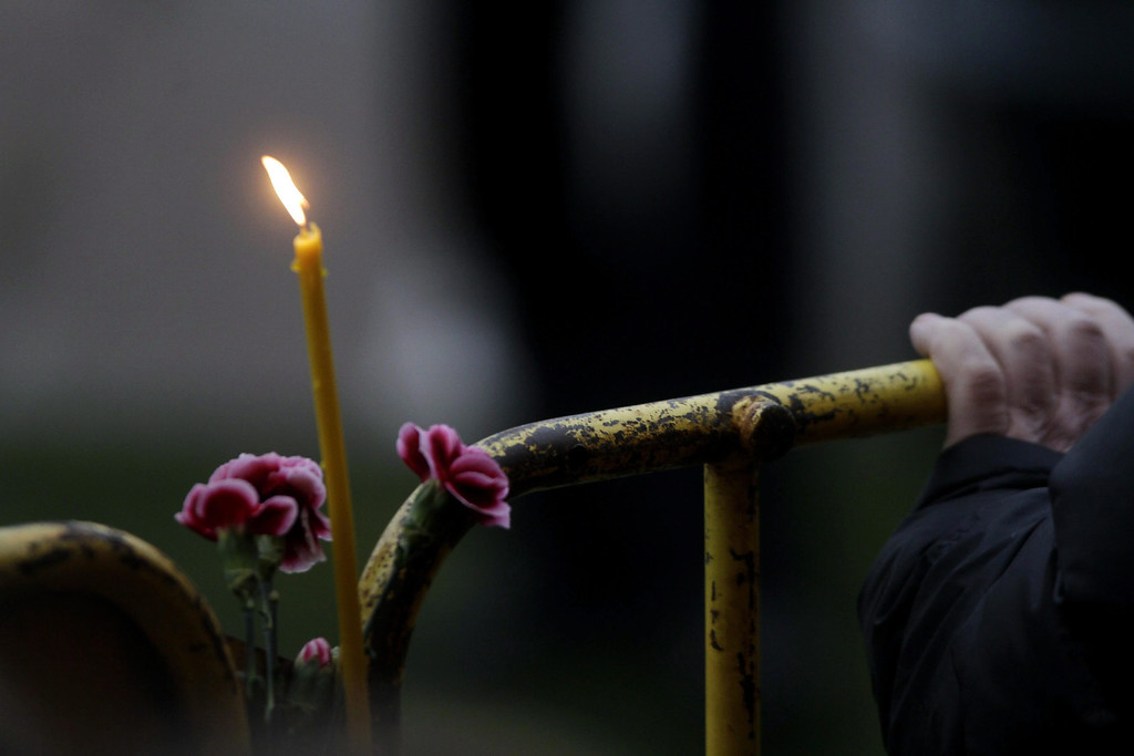 . Candles and flowers are laid in tribute to the victims of the roof collapse at Maxima supermarket in Riga, Latvia, 23 November 2013.   EPA/VALDA KALNINA