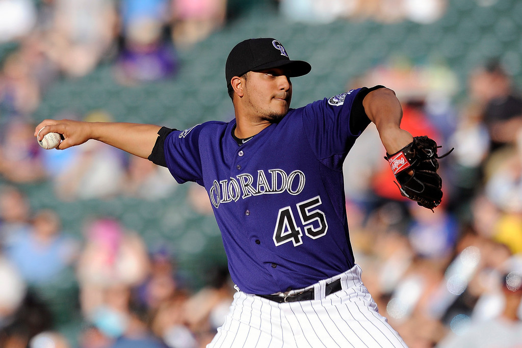 . Colorado Rockies starting pitcher Jhoulys Chacin throws in the first inning of a baseball game against the Washington Nationals on Tuesday, June 11, 2013 in Denver. (AP Photo/Chris Schneider)