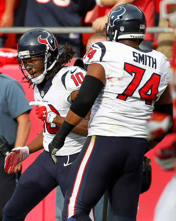 . Houston Texans wide receiver DeAndre Hopkins (10) celebrates his touchdown with guard Wade Smith (74) during the first half of an NFL football game against the Kansas City Chiefs at Arrowhead Stadium in Kansas City, Mo., Sunday, Oct. 20, 2013. (AP Photo/Colin E. Braley)