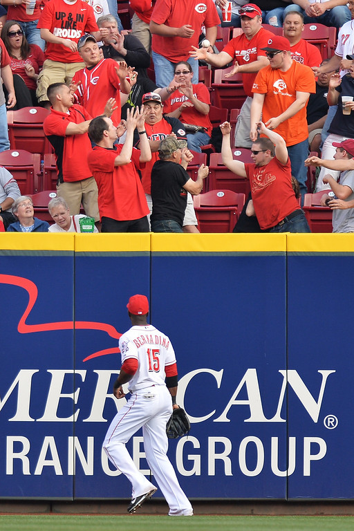 . CINCINNATI, OH - MAY 10:  Right fielder Roger Bernadina #15 of the Cincinnati Reds watches as a lead off home run off the bat of Charlie Blackmon #19 of the Colorado Rockies sails over the right field wall in the first inning at Great American Ball Park on May 10, 2014 in Cincinnati, Ohio.  (Photo by Jamie Sabau/Getty Images)