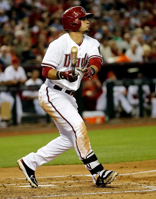 . Arizona Diamondbacks\' Gerardo Parra connects for a base hit against the Colorado Rockies during the third inning of a baseball game, Friday, April 26, 2013, in Phoenix. (AP Photo/Matt York)