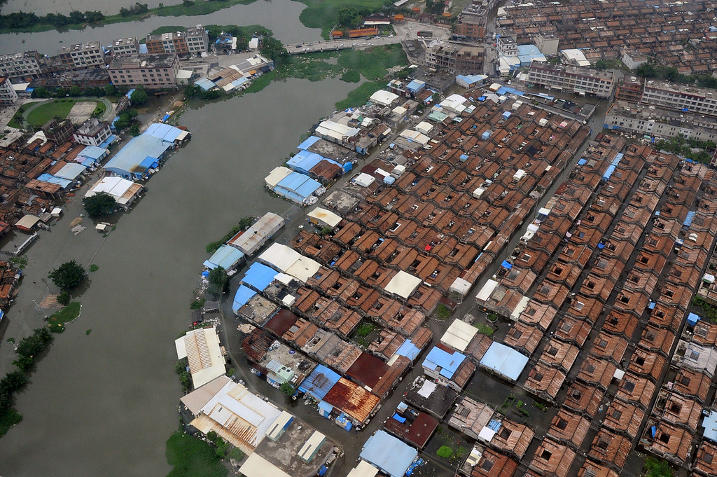 . A residential area with houses and streets submerged by floodwaters in Shantou, in southern China\'s Guangdong province on August 21, 2013. The death toll from devastating floods at opposite ends of China following torrential rains and the aftermath of a typhoon has risen to more than 130, the government and media said on August 20.   AFP PHOTOSTR/AFP/Getty Images