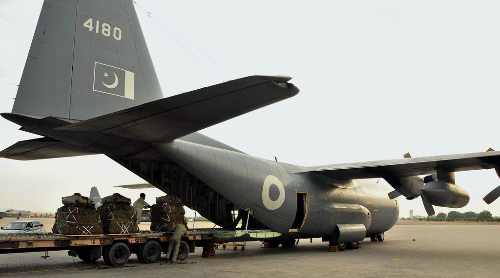 . In this photo released by Pakistan\'s Air Force on Saturday, Sept. 28, 2013, workers load relief goods into a C-130 plane for aerial drop into earthquake damaged areas at a base in Karachi, Pakistan. A major earthquake rocked Pakistan\'s southwest Saturday, sending people running into the street in panic just days after another quake in the same region killed hundreds of people, officials said. (AP Photo/Pakistan Air Force)