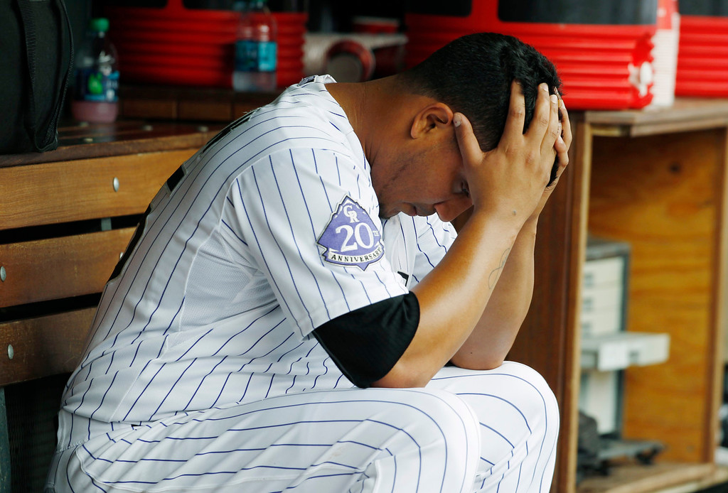 . Colorado Rockies starting pitcher Jhoulys Chacin sits in the dugout after giving up a run to the Milwaukee Brewers in the fourth inning of a baseball game in Denver on Sunday, July 28, 2013. (AP Photo/David Zalubowski)