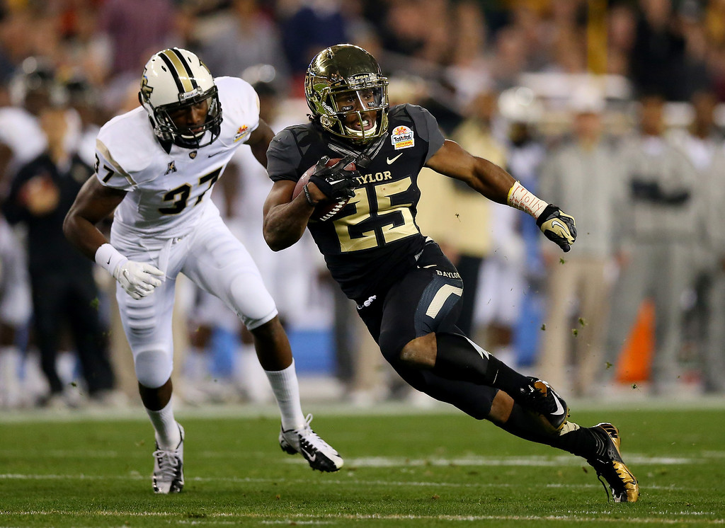 . GLENDALE, AZ - JANUARY 01:  Running back Lache Seastrunk #25 of the Baylor Bears carries the ball against the UCF Knights in the first quarter of the Tostitos Fiesta Bowl at University of Phoenix Stadium on January 1, 2014 in Glendale, Arizona.  (Photo by Ronald Martinez/Getty Images)