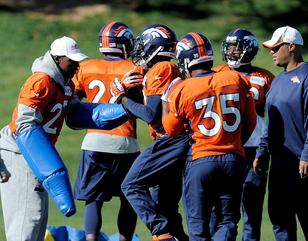 . ENGLEWOOD, CO - OCTOBER 27: Denver Broncos Knowshon Moreno (27) helps with drills during practice on October 30, 2013 at Dove Valley. (Photo by John Leyba/The Denver Post)