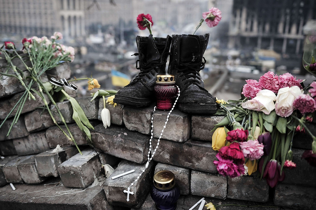 ". Boots belonging to a protester are left on a makeshift memorial at the Independence square in central Kiev on February 28, 2014. Ukraine accused Russia of staging an ""armed invasion\"" of Crimea on Friday as the ex-Soviet state\'s ousted leader prepared to emerge defiant from five days of hiding after winning protection from Moscow. AFP PHOTO/ LOUISA  GOULIAMAKI/AFP/Getty Images"
