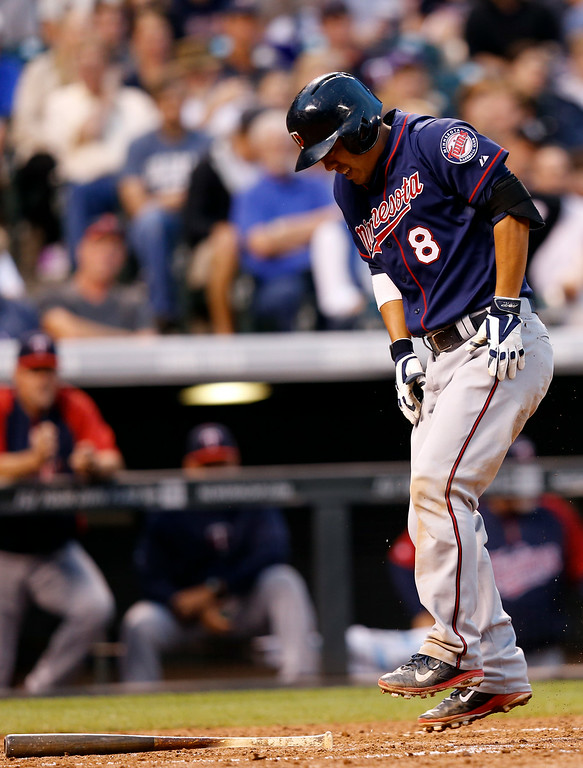 . Minnesota Twins\' Kurt Suzuki reacts after hitting a foul ball off against the Colorado Rockies during the fifth inning of a baseball game on Friday, July 11, 2014, in Denver. (AP Photo/Jack Dempsey)