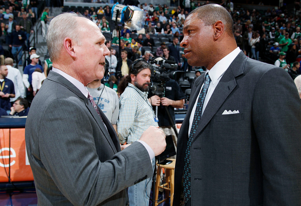 . Denver Nuggets coach George Karl, left, greets Boston Celtics coach Doc Rivers before an NBA basketball game in Denver on Tuesday, Feb. 19, 2013. (AP Photo/David Zalubowski)