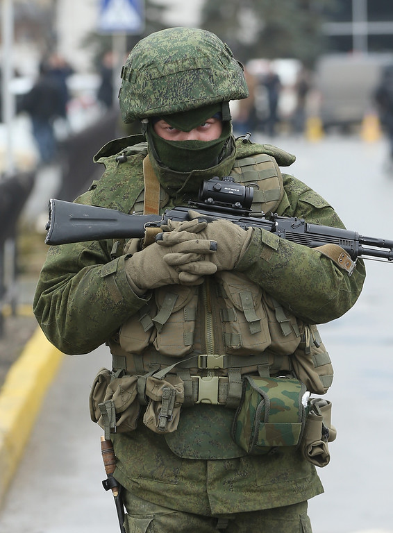 . A soldier, one of approximately 20 who were wearing no identifying insignia and declined to say whether they were Russian or Ukrainian, patrols outside the Simferopol International Airport after a pro-Russian crowd had gathered on February 28, 2014 near Simferopol, Ukraine.  (Photo by Sean Gallup/Getty Images)