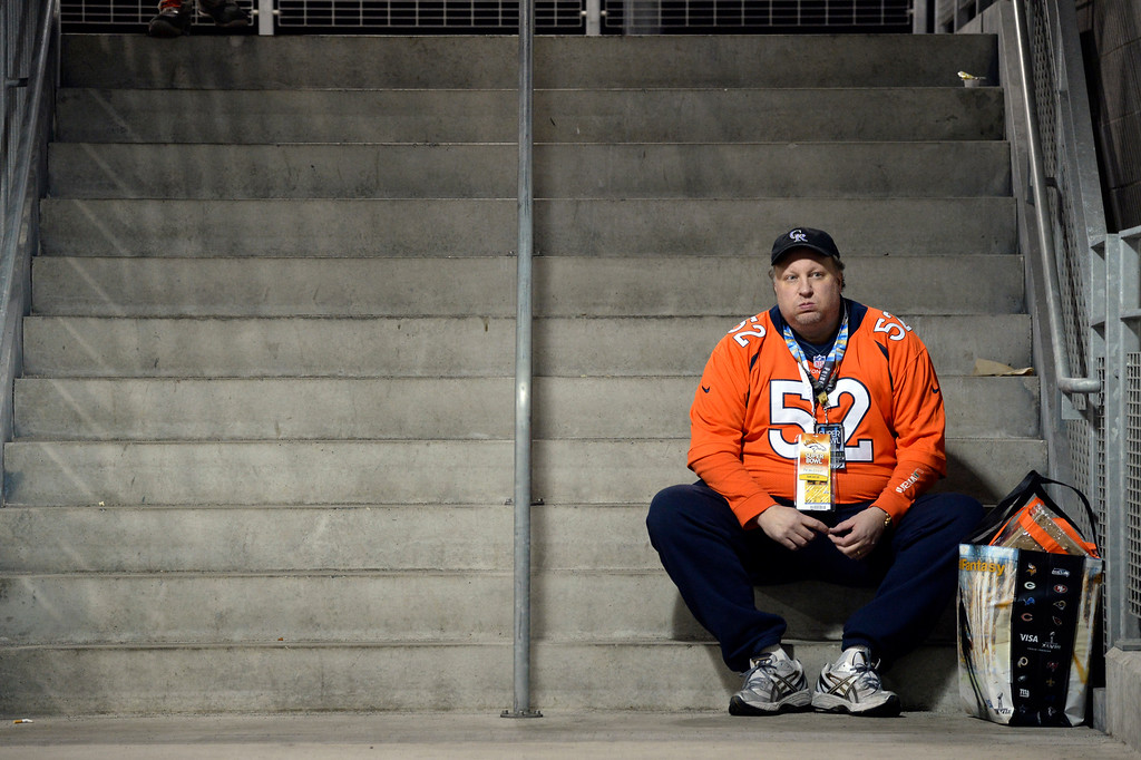 ". John Harding of Colorado Springs sits in the concourse during the 3rd quarter.  He said the Seattle fans never sit down and he can\'t see the game.  ""You know, it\'s like we didn\'t show up.  It\'s a bummer.  It reminds me of the old Super Bowls.  It\'s depressing.  It\'s really tough.\"" He paid $3,200 for a ticket. The Denver Broncos vs the Seattle Seahawks in Super Bowl XLVIII at MetLife Stadium in East Rutherford, New Jersey Sunday, February 2, 2014. (Photo by Craig F. Walker/The Denver Post)"