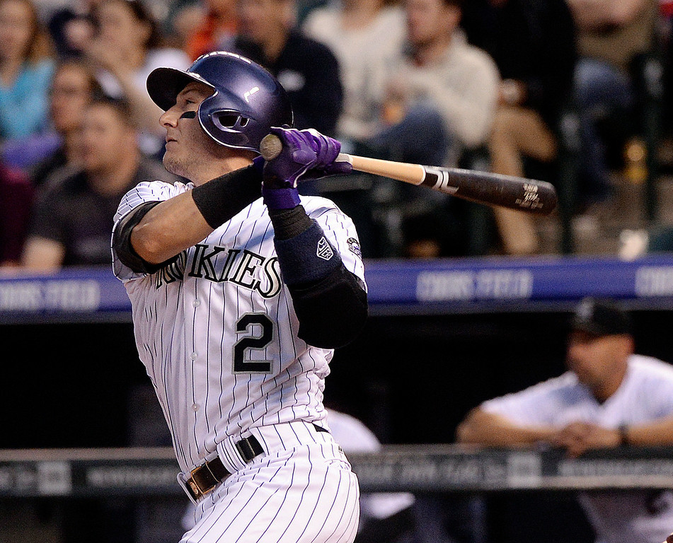 . DENVER, CO - APRIL 18: Colorado batter Troy Tulowitzki watched his home run ball head for the fence in the second inning. The Colorado Rockies hosted the Philadelphia Phillies Friday night, April 18, 2014 at Coors Field.  (Photo by Karl Gehring/The Denver Post)