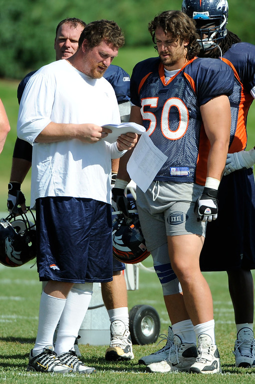 . Denver Broncos Tom Nalen chats with Ben Hamilton (50)  during practice on day 10 of camp August 4, 2008 at Dove Valley.  John Leyba/The Denver Post