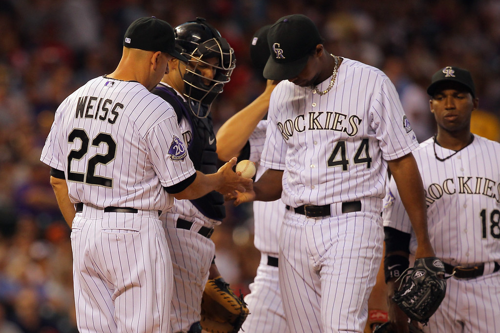 . DENVER, CO - JUNE 14:  Manager Walt Weiss #22 of the Colorado Rockies removes starting pitcher Juan Nicasio #44 of the Colorado Rockies from the game against the Philadelphia Phillies in the sixth inning at Coors Field on June 14, 2013 in Denver, Colorado.  (Photo by Doug Pensinger/Getty Images)