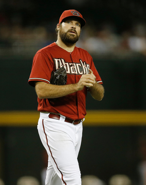 . Arizona Diamondbacks pitcher Josh Collmenter looks upward after giving up the second run against the Colorado Rockies during the third inning of a baseball game on Wednesday, April 30, 2014, in Phoenix. (AP Photo/Matt York)