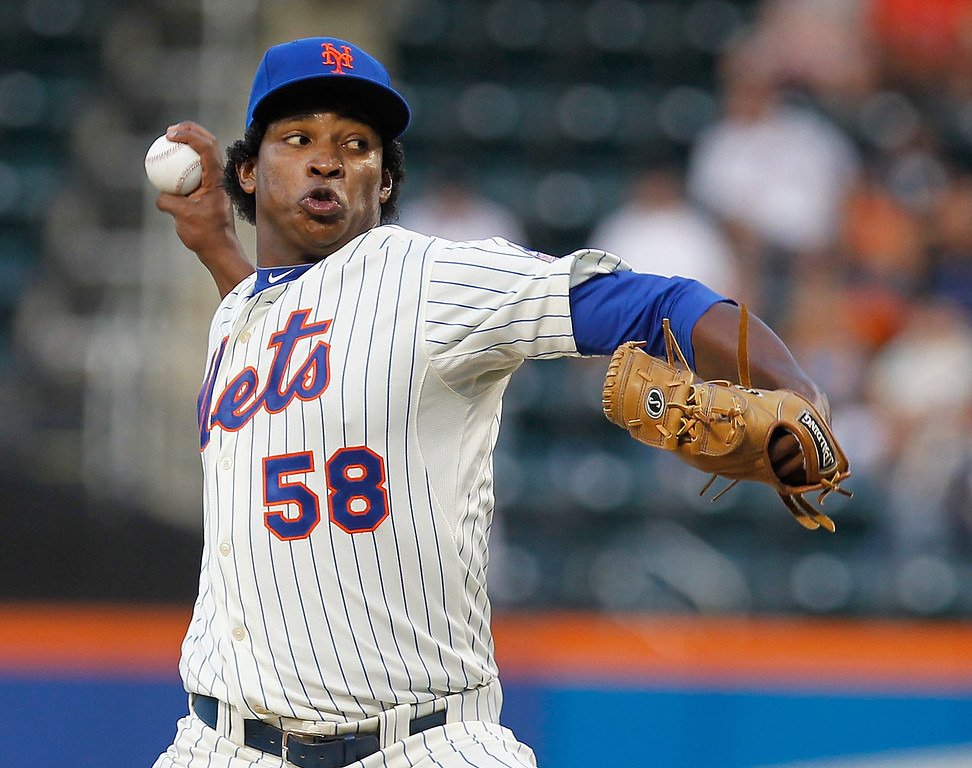 . Jenrry Mejia #58 of the New York Mets pitches in the first inning against the Colorado Rockies at Citi Field on August 6, 2013 at Citi Field in the Flushing neighborhood of the Queens borough of New York City.  (Photo by Mike Stobe/Getty Images)