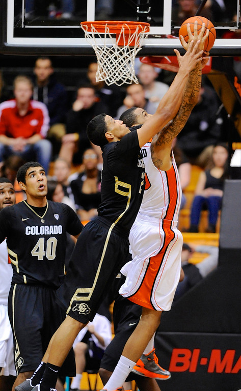 . Oregon State\'s Eric Moreland (15) grabs a defensive rebound against Colorado\'s Andre Robinson (21) during the second half of an NCAA college basketball game in Corvallis, Ore., Sunday, Feb. 10, 2013. Colorado won 72-68. (AP Photo/Greg Wahl-Stephens)