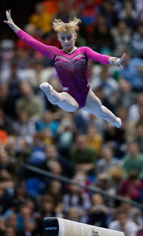 . Russia\'s Anastasia Grishina competes on the beam during the women\'s apparatus finals at the European Men\'s and Women\'s Artistic Gymnastic individual Championships in Moscow April 21, 2013.  REUTERS/Grigory Dukor