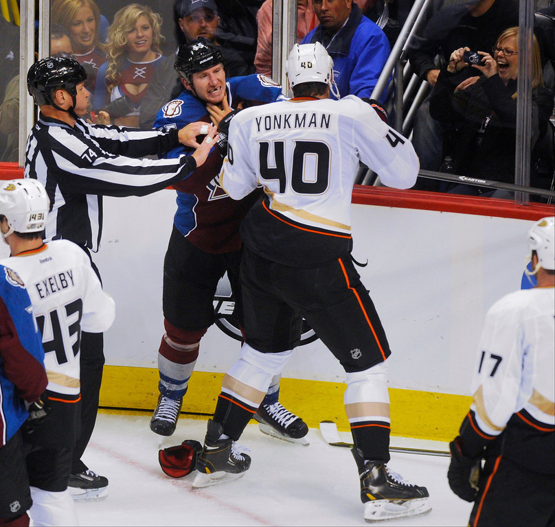 . A referee moved in to break up a skirmish between Colorado winger Cody McLeod (55) and Anaheim defenseman Nolan Yonkman (40) in the second period.  Photo By Karl Gehring/The Denver Post