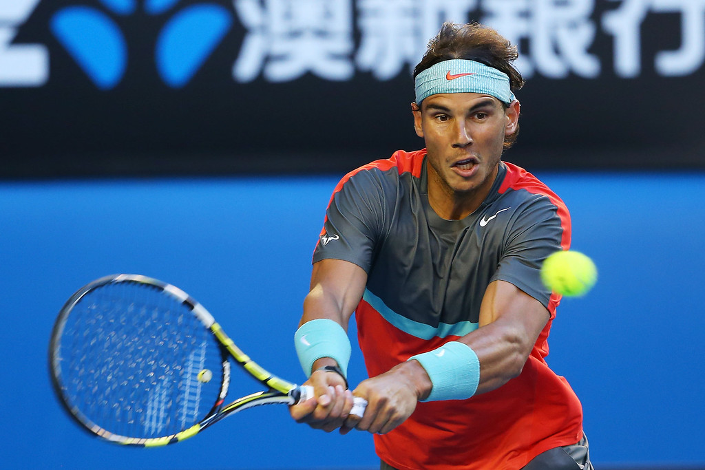 . Rafael Nadal of Spain plays a backhand in his men\'s final match against Stanislas Wawrinka of Switzerland during day 14 of the 2014 Australian Open at Melbourne Park on January 26, 2014 in Melbourne, Australia.  (Photo by Quinn Rooney/Getty Images)