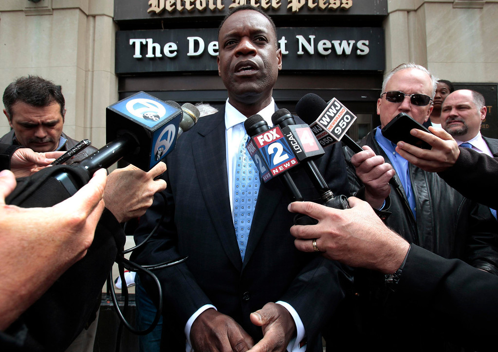 . Detroit\'s Emergency Financial Manager Kevyn Orr talks to members of the media outside the Detroit Newspapers building in Detroit, Michigan in this file photo taken May 13, 2013.  The city of Detroit is in final preparations to file for federal bankruptcy as early as Friday morning, the Detroit Free Press reported on Thursday, citing several unnamed sources.   REUTERS/ Rebecca Cook