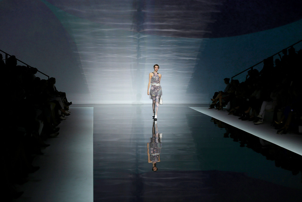 . A model wears a creation for Emporio Armani women\'s Spring-Summer 2014 collection, part of the Milan Fashion Week, unveiled in Milan, Italy, Friday, Sept. 20, 2013. (AP Photo/Luca Bruno)
