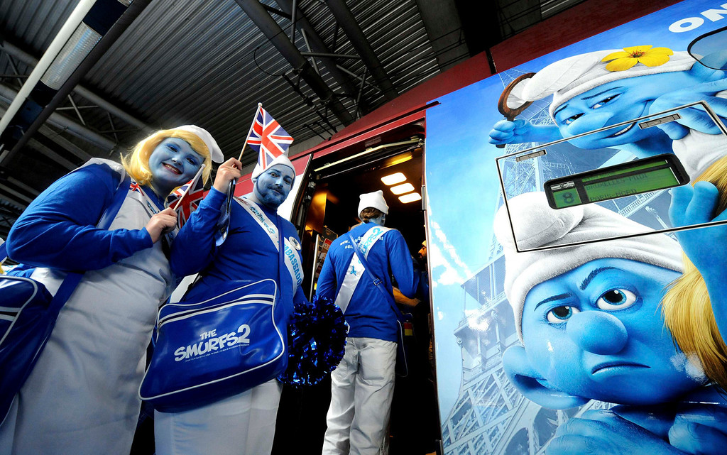 """. Smurf Ambassadors pose in front of a Thalys train decorated for the film \""""The Smurfs 2\"""" during a celebration for the birthday of Peyo, the creator of the Smurfs, on \""""Global Smurfs Day\"""" in Brussels, June 22, 2013. The event was held ahead of the release of the film, according to organizers. REUTERS/Laurent Dubrule"""