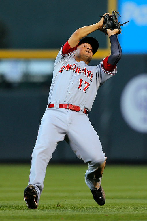 . Cincinnati Reds second baseman Kris Negron falls back as he catches a pop fly by Colorado Rockies\' Drew Stubbs during the third inning of a baseball game Friday, Aug. 15, 2014, in Denver. (AP Photo/Jack Dempsey)