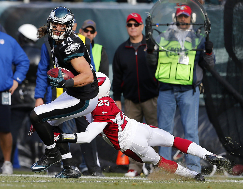 . Wide receiver Riley Cooper #14 of the Philadelphia Eagles makes a catch for a first down as he breaks the tackle of cornerback Jerraud Powers #25 of the Arizona Cardinals in the second quarter during a game at Lincoln Financial Field on December 1, 2013 in Philadelphia, Pennsylvania. (Photo by Rich Schultz /Getty Images)