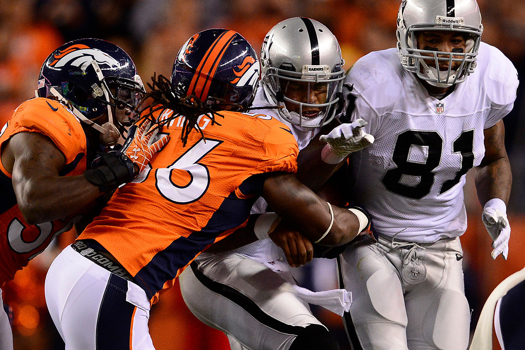 . DENVER, CO - SEPTEMBER 23: Oakland Raiders quarterback Terrelle Pryor (2) is tackled by Denver Broncos linebacker Nate Irving (56) in the second quarter. The Denver Broncos took on the Oakland Raiders at Sports Authority Field at Mile High in Denver on September 23, 2013. (Photo by AAron Ontiveroz/The Denver Post)