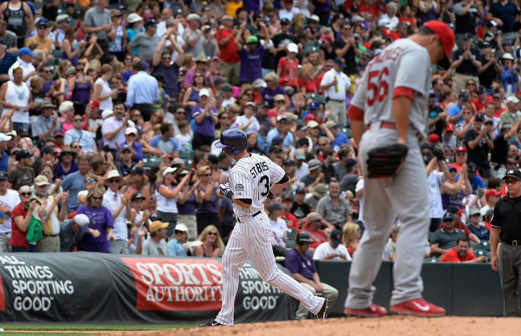 . Colorado Rockies center fielder Drew Stubbs (13) rounds third base after hitting a home run int he fourth inning off of St. Louis Cardinals starting pitcher Marco Gonzales (56) June 25, 2014 at Coors Field. (Photo by John Leyba/The Denver Post)
