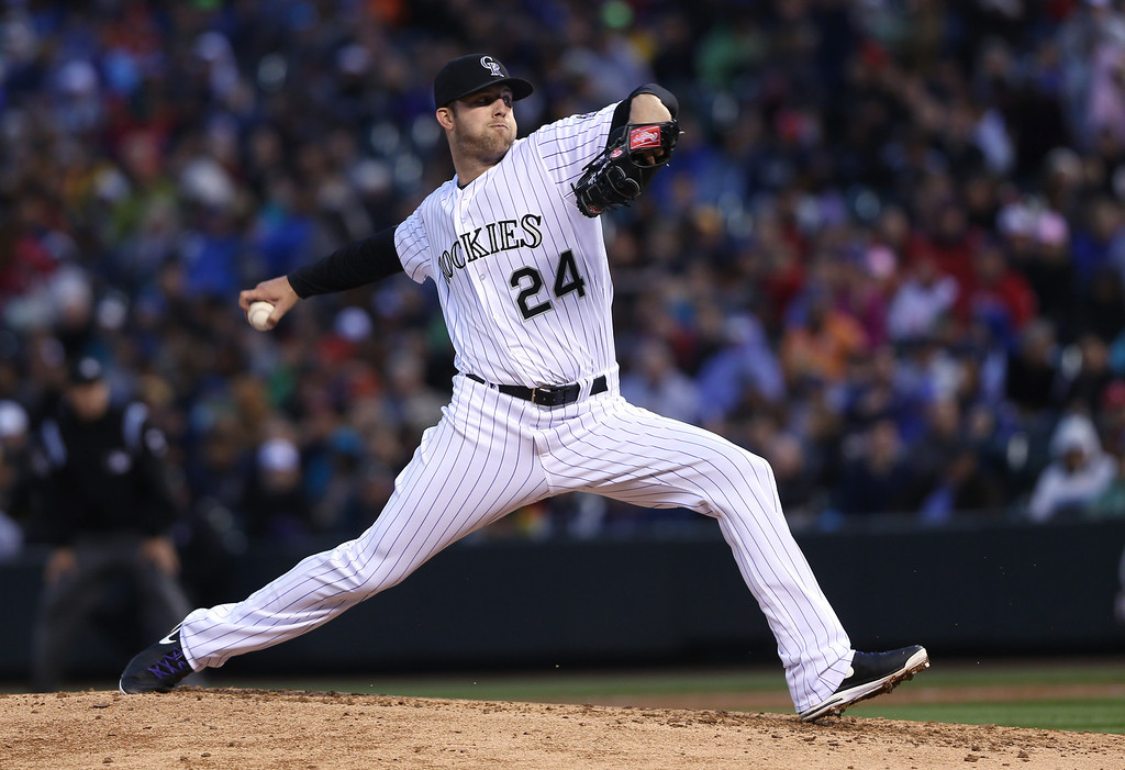 . Colorado Rockies starting pitcher Jordan Lyles works against the Philadelphia Phillies in the fourth inning of a baseball game in Denver on Saturday, April 19, 2014. (AP Photo/David Zalubowski)