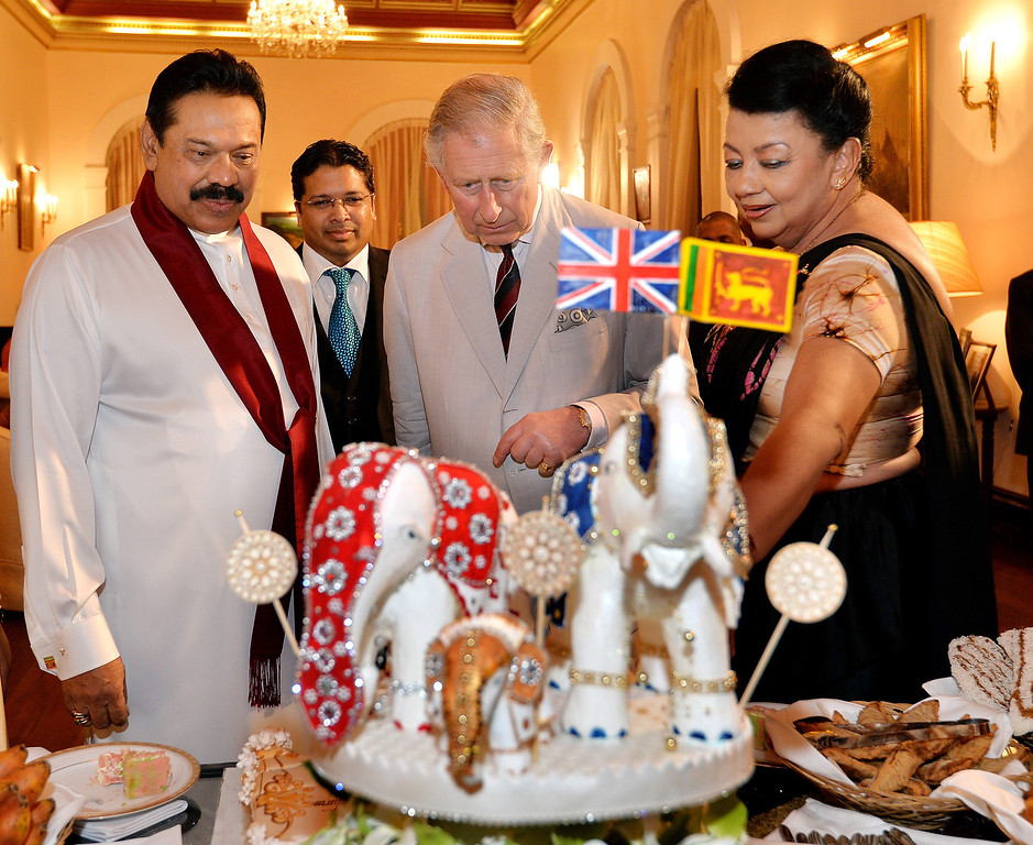 . Prince Charles, Prince of Wales (centre) is presented with a birthday cake topped with three Elephants, by the President of Sri Lanka Mahinda Rajapaksa (left) and his wife Shiranthi (right) at the Presidents Palace on November 14, 2013 in Colombo, Sri Lanka.   (Photo by John Stillwell  -  Pool/Getty Images)