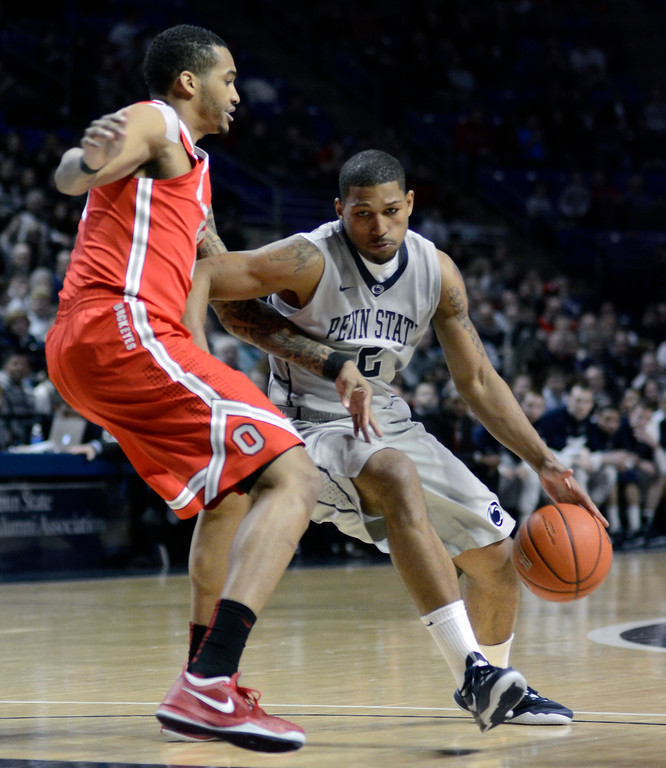 . Penn State\'s D.J. Newbill, right, moves toward the paint around Ohio State\'s LaQuinton Ross during the first half of an NCAA college basketball game on Thursday, Feb. 27, 2014 in State College, Pa. (AP Photo/Ralph Wilson)