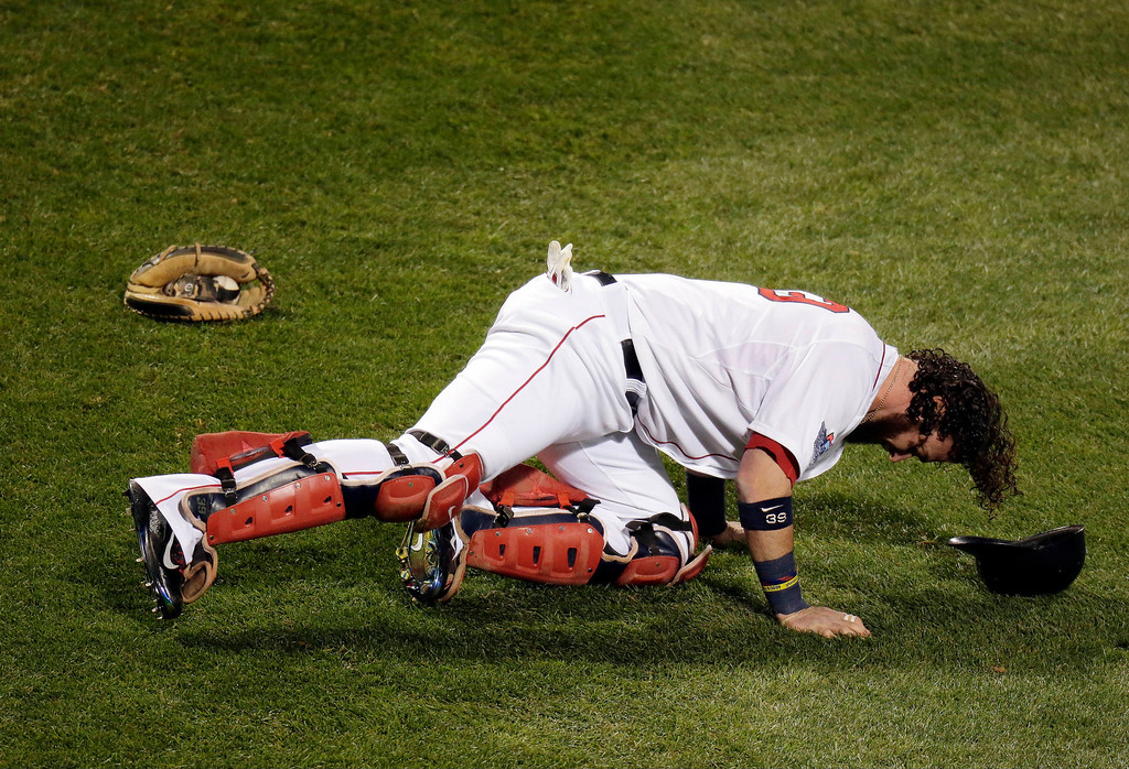 . Boston Red Sox catcher Jarrod Saltalamacchia stretches before Game 2 of baseball\'s World Series against the St. Louis Cardinals Thursday, Oct. 24, 2013, in Boston. (AP Photo/Charlie Riedel)