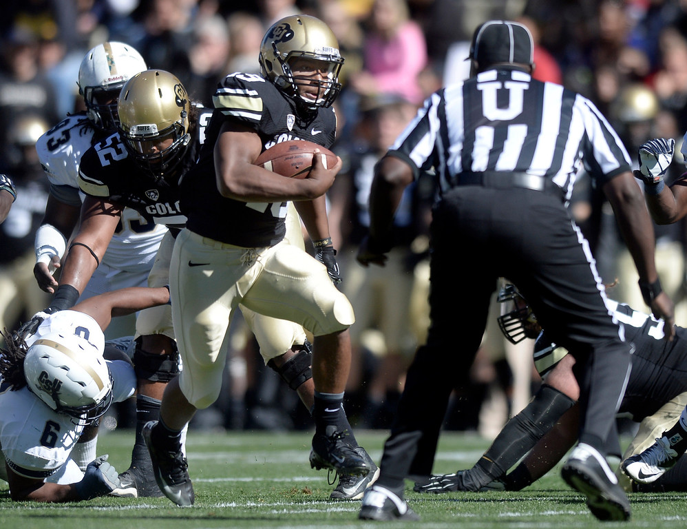 . University of Colorado\'s Michael Adkins II finds a hole in the line while rushing the ball during a game against Charleston Southern on Saturday, Oct. 19, at Folsom Field in Boulder.  (Jeremy Papasso/Boulder Daily Camera)