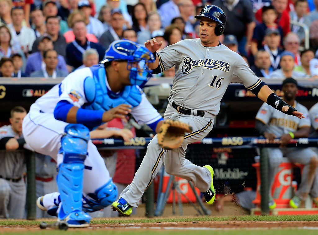 . National League All-Star Aramis Ramirez #16 of the Milwaukee Brewers scores against the American League All-Stars during the 85th MLB All-Star Game at Target Field on July 15, 2014 in Minneapolis, Minnesota.  (Photo by Rob Carr/Getty Images)