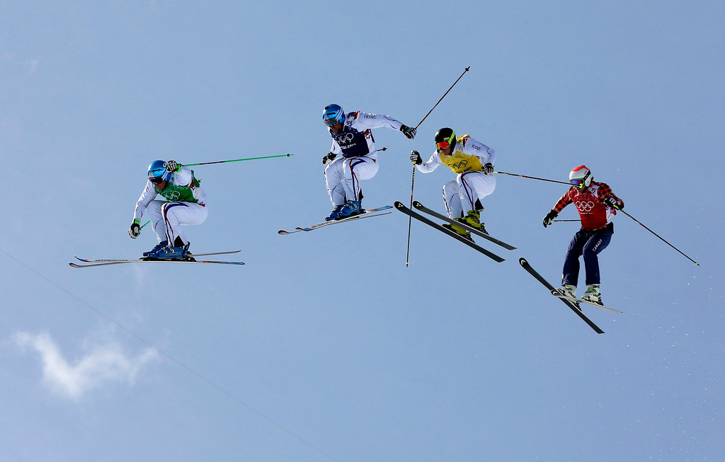 . (L-R) Jean Frederic Chapuis of France, Arnaud Bovolenta of France, Jonathan Midol of France and Brady Leman of Canada in action during the Men\'s  Ski Cross Final at Rosa Khutor Extreme Park during the Sochi 2014 Olympic Games, Krasnaya Polyana, Russia, 20 February 2014.  EPA/VALDRIN XHEMAJ
