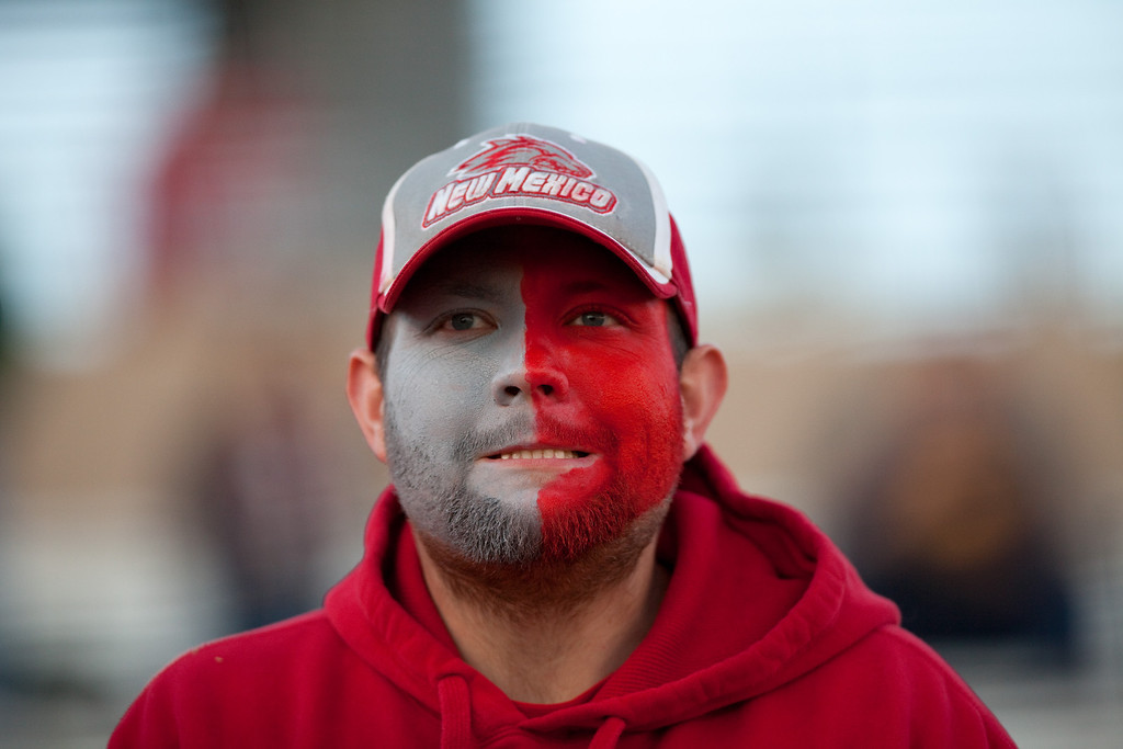 . A unidentified New Mexico supporter looks on pensively in the first half of an NCAA college football game against Colorado State on Saturday, Nov. 16, 2013 in Albuquerque, N.M. Colorado State won 66-42. (AP Photo/Eric Draper)