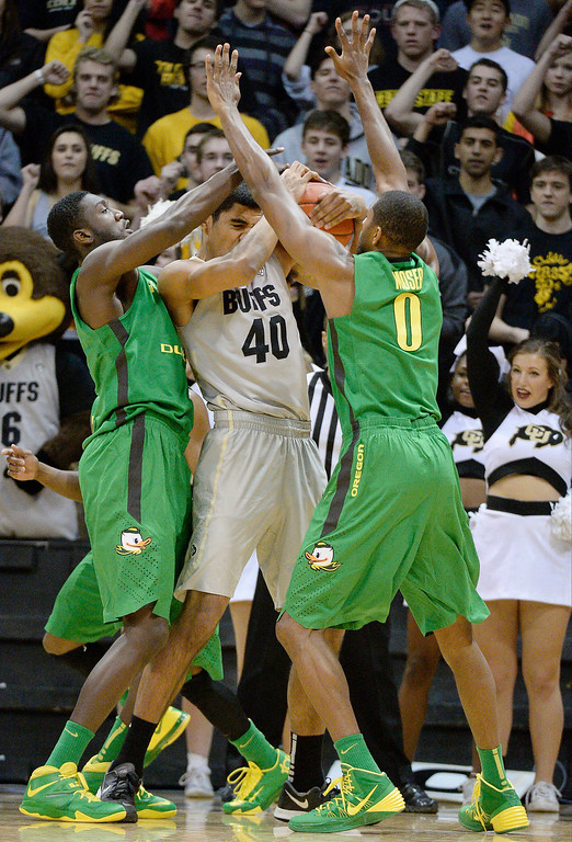 . Colorado Buffaloes forward Josh Scott (40) gets double teamed by Oregon Ducks forward Mike Moser (0) and Oregon Ducks forward Richard Amardi (13) during the first half January 5, 2014 at Coors Events Center. (Photo by John Leyba/The Denver Post)