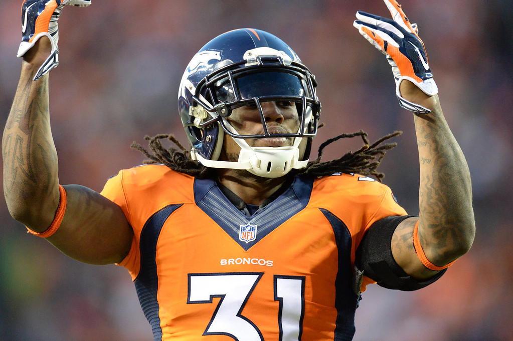 . Denver Broncos strong safety Omar Bolden (31) celebrates a play in the fourth quarter. The Denver Broncos take on the San Diego Chargers at Sports Authority Field at Mile High in Denver on January 12, 2014. (Photo by Hyoung Chang/The Denver Post)