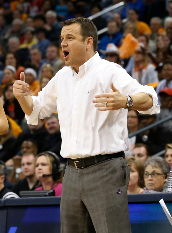 . Louisville coach Jeff Walz shouts during the first half against Tennessee in the regional final of the NCAA women\'s college basketball tournament in Oklahoma City, Tuesday, April 2, 2013.  (AP Photo/Sue Ogrocki)