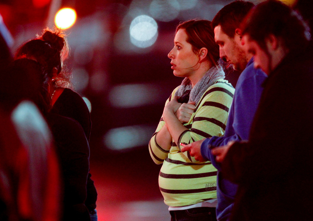 . Onlookers observe the scene outside Clackamas Town Center in Clackamas, Ore., where a shooting occurred Tuesday, Dec. 11, 2012. A gunman opened fire in the Portland, Ore., area shopping mall Tuesday, killing at least one person and wounding an unknown number of others, sheriff\'s deputies said. (AP Photo/The Oregonian, Bruce Ely)