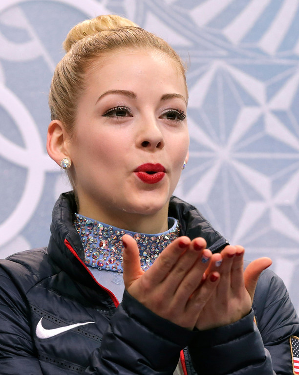 . Gracie Gold of the United States blows a kiss to spectators as she waits in the results area after completing her routine in the women\'s free skate figure skating finals at the Iceberg Skating Palace during the 2014 Winter Olympics, Thursday, Feb. 20, 2014, in Sochi, Russia. (AP Photo/Bernat Armangue)